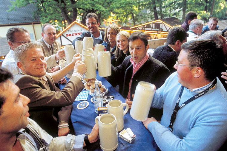 Visitors clink mugs at the annual festival called Bergkirchweih in Erlangen, southern Germany, in May 2005.