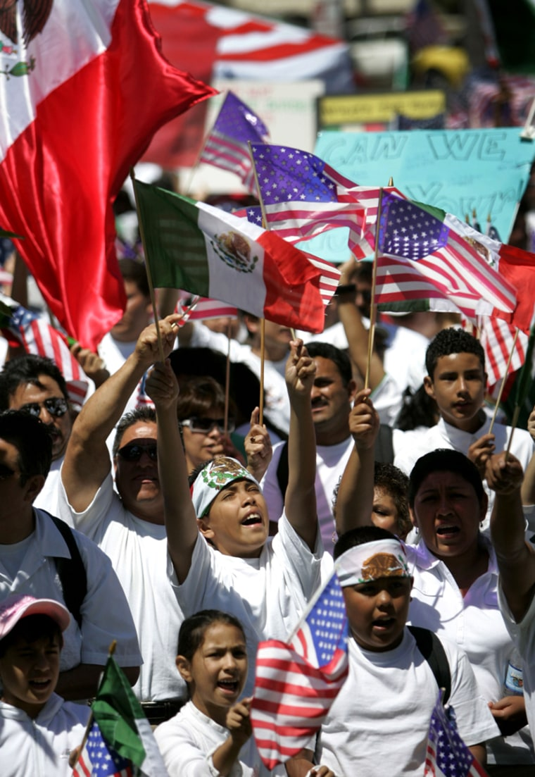 Protesters in support of immigrant rights cheer during the Immigration March for Dignity, Respect, and Hope in downtown San Diego on Sunday.