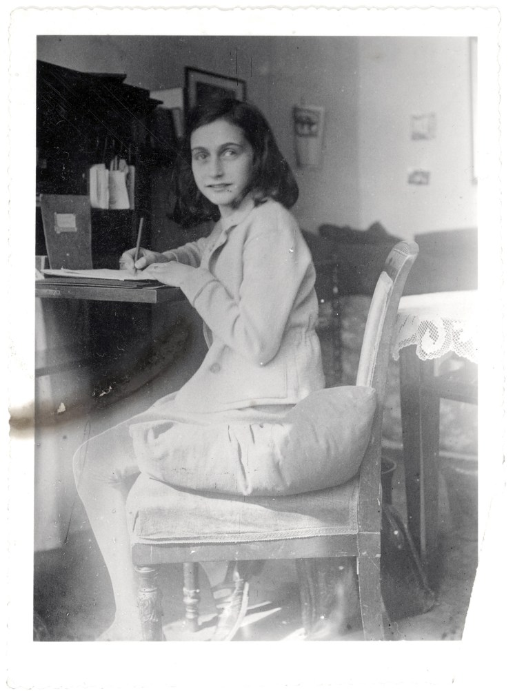 Anne Frank writes at a desk in this April 1941 image released by the Anne Frank Foundationon Tuesday.