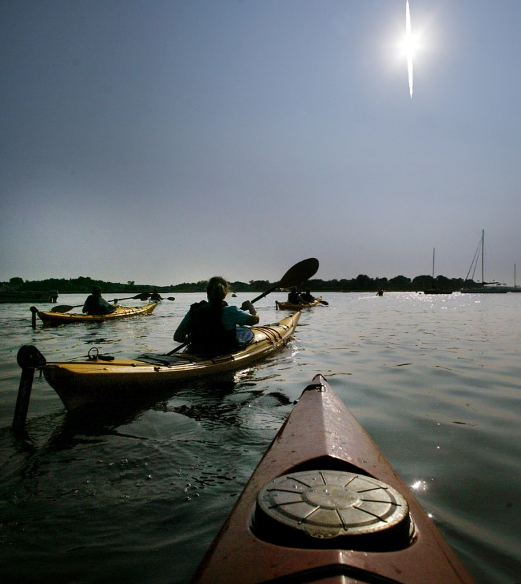 A tour group paddles their kayaks on the Essex River basin off Essex, Mass., Sept. 13, 2005.
