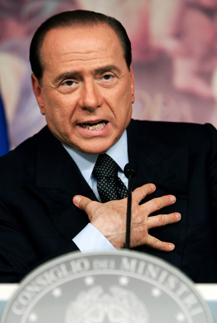 Italian PM Berlusconi gestures during news conference in Rome
