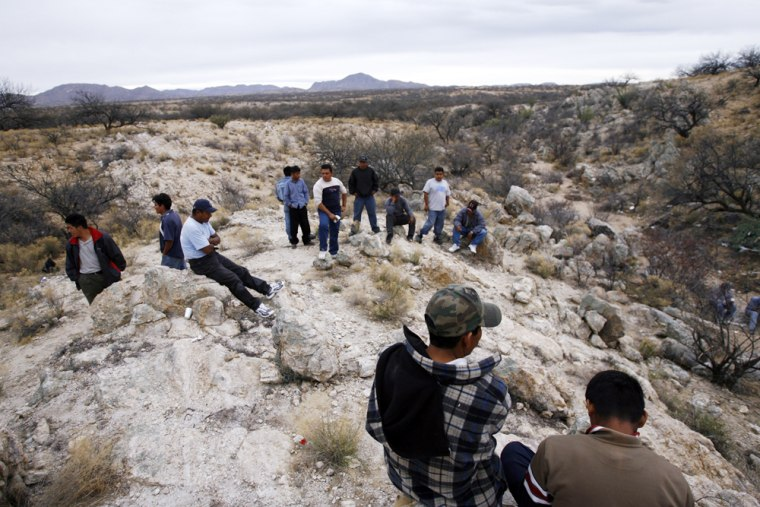 Mexican migrants from the state of Chiapas wait for nightfall to begin crossing the Arizona desert into the U.S. near the town of Sasabe, Mexico, in this April 4 photo.