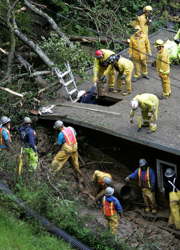 Rescuers Search For Man Trapped In Mudslide