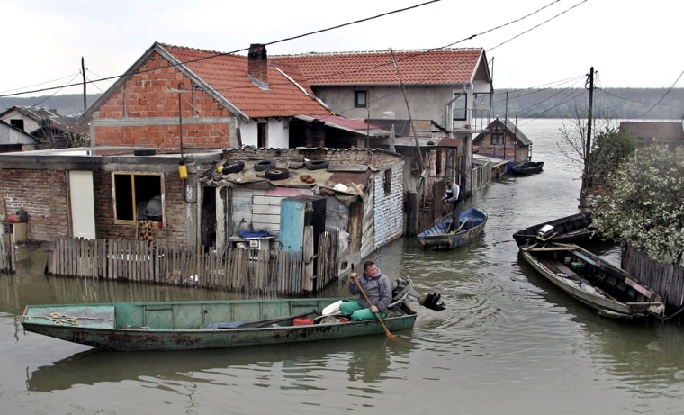 People in a boat inspect a home flooded by the Danube river, in Smederevo, south of Belgrade, on Thursday. Serbia has declared a state of emergency in the northern parts of the country after weeks of flooding throughout central Europe.