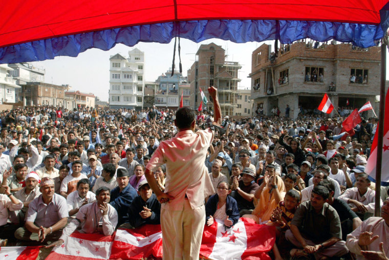 Opposition party supporters listen Thursday to a leader at a meeting in Katmandu, Nepal. The government has banned rallies in Katmandu and surrounding areas.