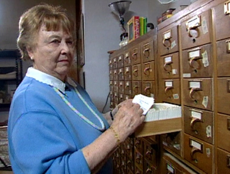 Gladys Hansen, seen herein the stacks of a warehouse in San Francisco's Mission district, where she works on her life long goal to account for thenumber of people killed by the 1906 earthquake.