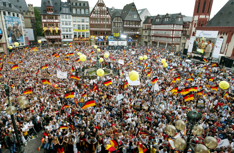 Thousands of German soccer fans celebrate prior to the reception of the German national soccer team returning from the soccer World Cup in Korea and Japan in this July 1, 2002, file photo. Germany is hoping that the million soccer fans expected for the 2006 World Cup will give its torpid economy a mighty kick.