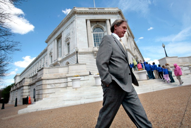 Sen. Lincoln Chafee (R-R.I.) walks by the Russell Senate Office Building in Washington, D.C.
