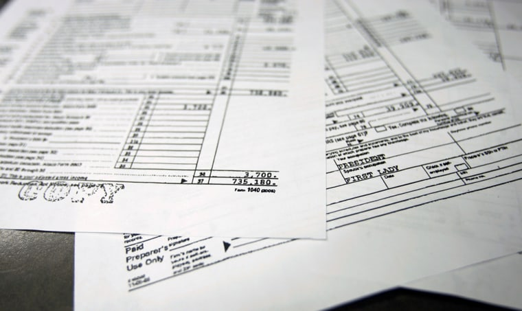 Copies of President Bush's and first lady Laura Bush's 2005 tax returns released by the White House are shown in Washington onFriday. It shows an adjusted gross income of $735,180.
