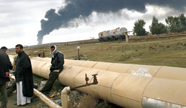 Black smoke rises into sky as waste oil burns outside Iraq's largest refinery near Baiji