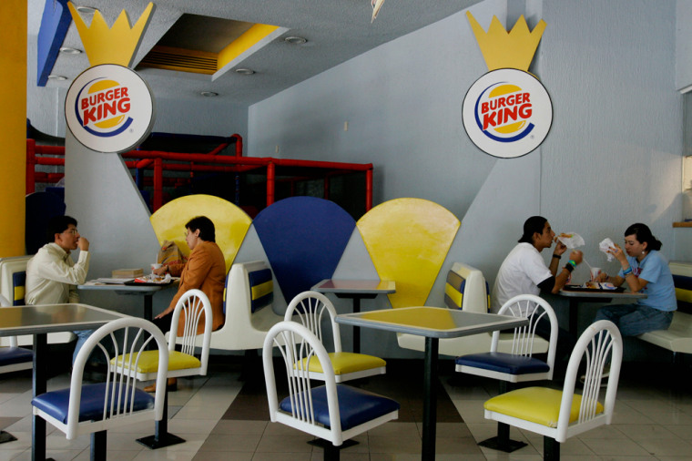 Two couples eat at a Burger King in Mexico City, Mexico on Wednesday. Immigrant groups in the United States are calling on their countrymen in Mexico to boycott U.S. products and businesses on May 1 to pressure the U.S. Congress to approve citizenship for undocumented migrants.