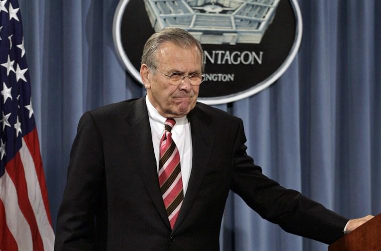 US Secretary of Defense Rumsfeld leaves after news briefing at Pentagon