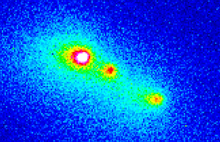 A false-color view of Comet Schwassmann-Wachmann 3 — produced by the European Southern Observatory's New Technology Telescope in Chile on Jan. 31, 1996 —shows three distinct fragments of the comet after its breakup.