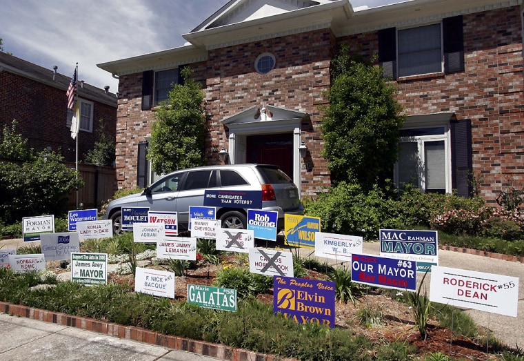 Candidates for mayor of New Orleans have placed their campaign signs in front of an Uptown house in the Crescent City. The city'sfirst major election since Hurricane Katrina struck is Tuesday.