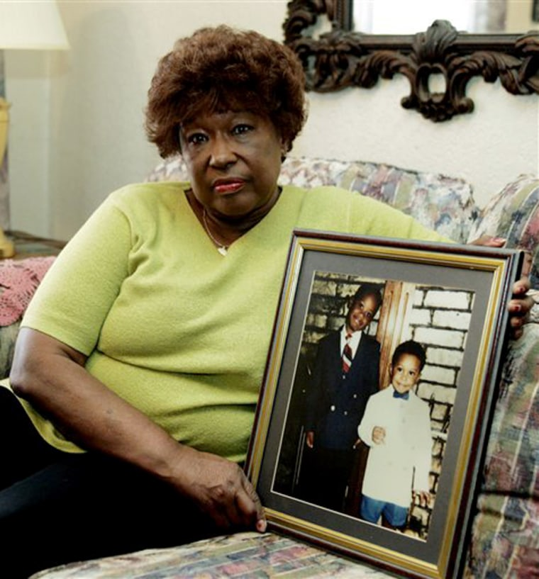 Jannie Coverdale poses on April 14 at her home in Oklahoma City with a photo of her grandsons, Aaron, left in the photo, and Elijah, who were killed in the Oklahoma City bombing in 1995.