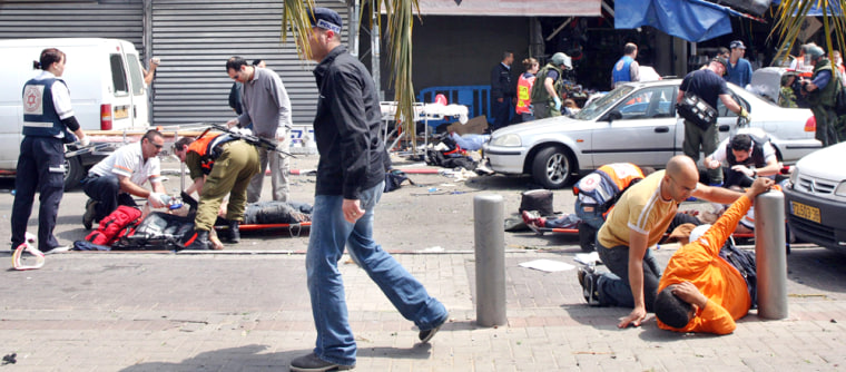 Israeli medical personnel help wounded civilians, following a suicide attack at Tel Aviv's old central bus station