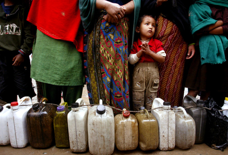 Nepalese stand in line to buy kerosene in Katmandu on Tuesday. A general strike hasemptied Nepal's highways, leaving Katmandu and other cities low on fresh food and fuel.