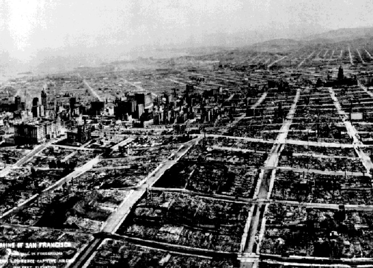 This photograph, taken from a tethered balloon five weeks after the great earthquake of April 18, 1906, shows the devastation brought on the city of San Francisco by the quake and subsequent fire. The view is looking over Nob Hill toward business district, South of the Slot, and the distant Mission. The Fairmont Hotel, far left, dwarfs the Call Building.
