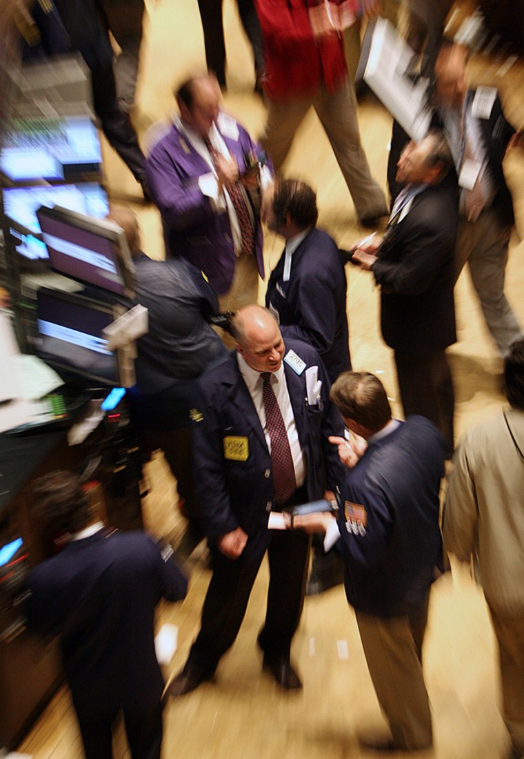 Traders and specialist work on floor of New York Stock Exchange in New York