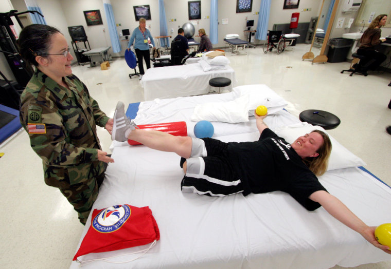 Sgt. Carla Best, who lost her leg in Iraq, works with her physical therapist, Capt. Marilyn Rodgers, in the at Walter Reed Hospital.