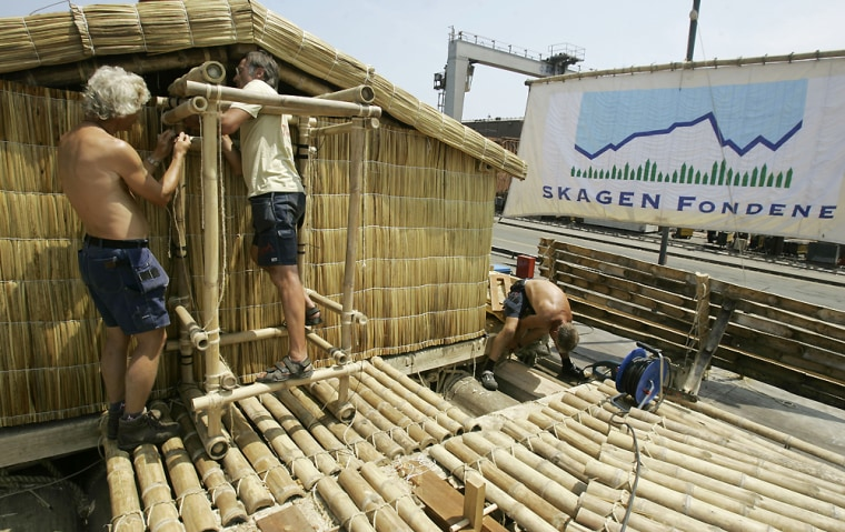 "Norwegian explorers work on a wooden raft in the port of Callao in Lima, Peru, on Wednesday. The raft, named ""Tangaroa"" after the Polynesian god of the ocean, is being prepared for a 5,000-mile Pacific odyssey."