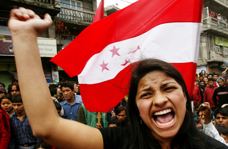 An opposition party supporter demonstrates against King Gyanendra in Katmandu, Nepal, on Wednesday as bloody protests continuedfor athird week.