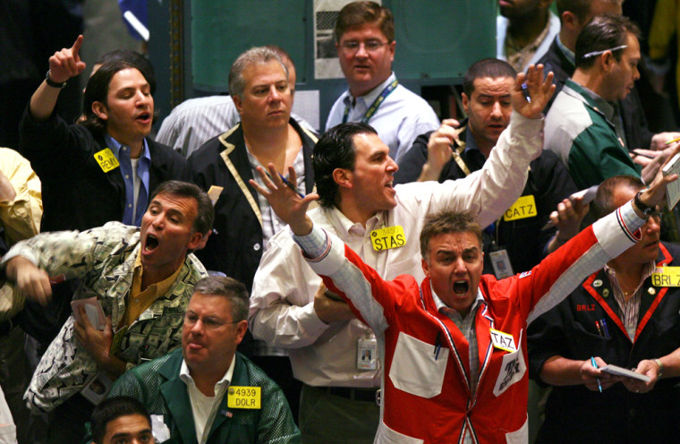 Traders work in the crude oil futures pit of the New York Mercantile Exchangethis week asoil prices hit a record high.