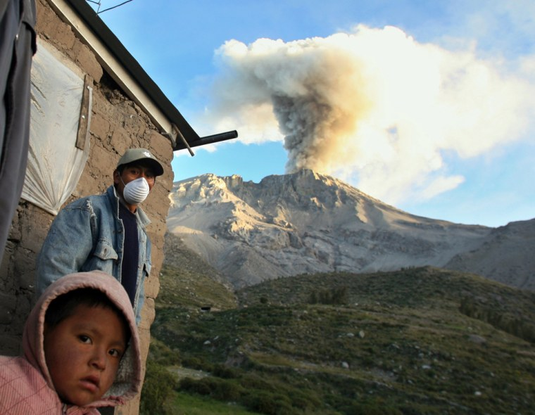Local resident wears mask to protect himself from ashes spewing from Peru's volcano Ubinas in Querapi