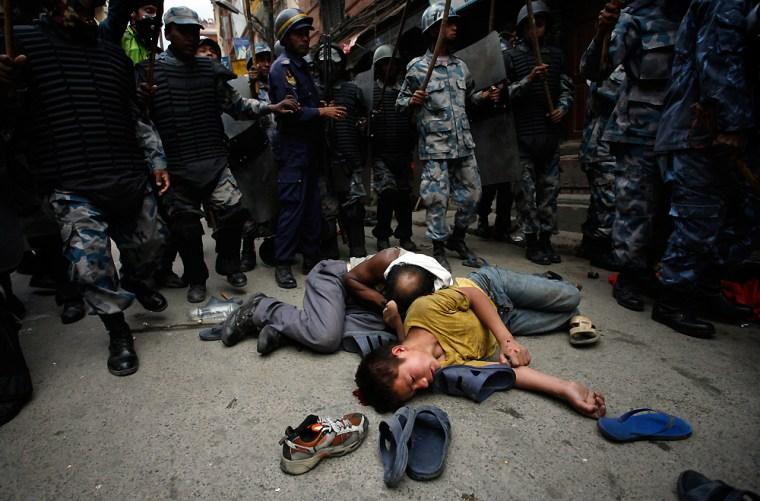 Nepalese pro-democracy protestors lie in