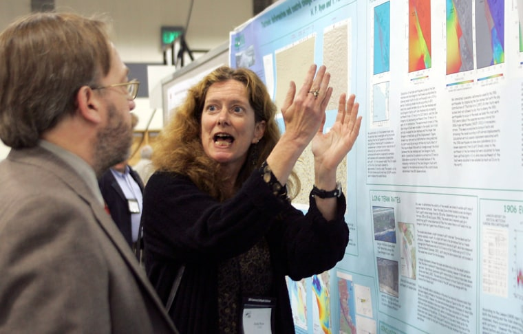 Holly Ryan, a geologist with USGS from Menlo Park, Calif., right, describes her poster to Frederick Schult, a geophysicist, during the 100th Anniversary Earthquake Conference at The Moscone Center in San Francisco on April 19.