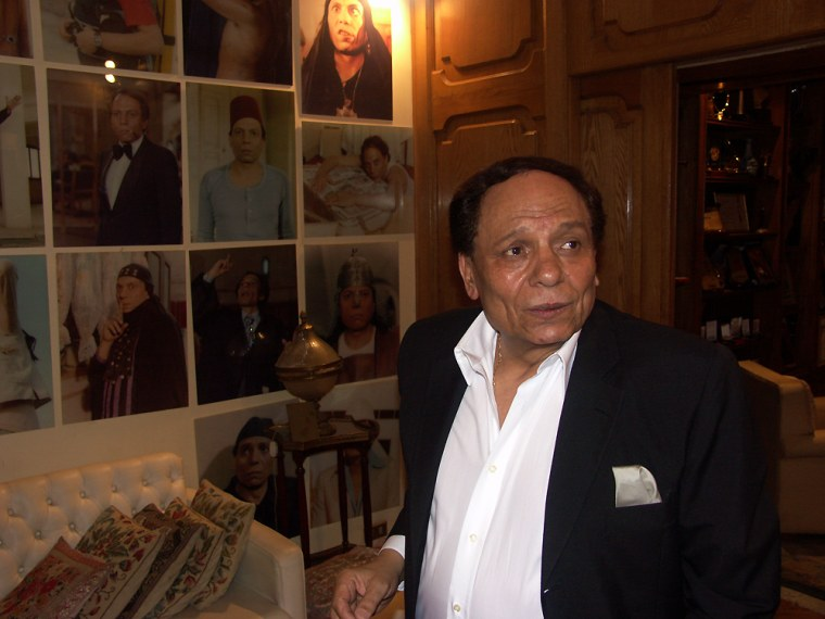 Adel Imam at home in front of portraits of him from movie roles that have made him Egypt's and the Middle East's best known comic.