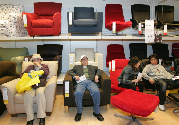 Japanese shoppers sit on IKEA's sofas at store in Funabashi