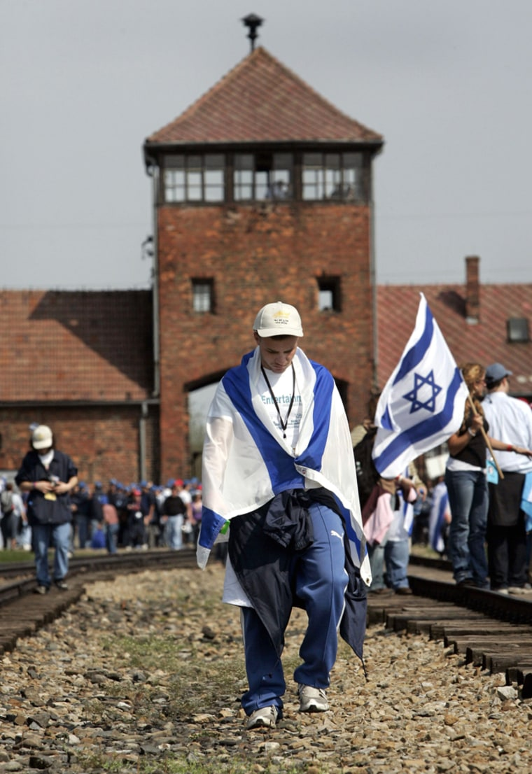 Youth walks in front of main railway building of former Nazi death camp of Birkenau in Oswiecim