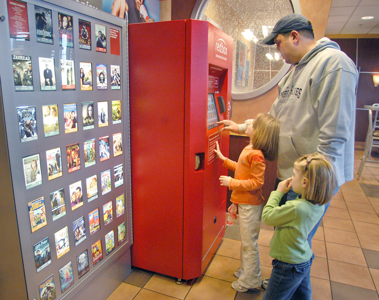 Chris Kliner and his daughters Olivia, 5, right, and Annaliese, 4, select a rental DVD from a Redbox before heading in to eat at McDonald's in Apple Valley, Minn. The fast-food giant is hoping the convenience of renting DVDs at its restaurants will turn into handsomeprofits.