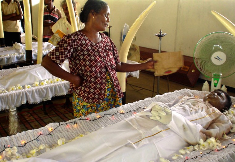 Chandrawathi, mother of 16-year old Lalith Bandara, grieves Tuesday duringthe boy'sfuneral at a Buddhist temple in Kalyanipura, a village near Trincomalee, northeast of Colombo, Sri Lanka.