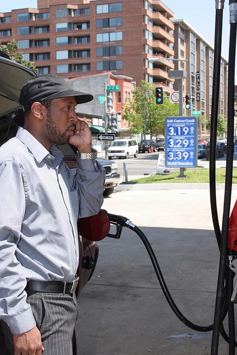 Jamal Blair fills his SUV at a Mobil gas