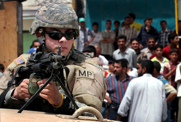 A U.S. military policeman secures the scene of a bomb explosion in Sadr City on Tuesday.