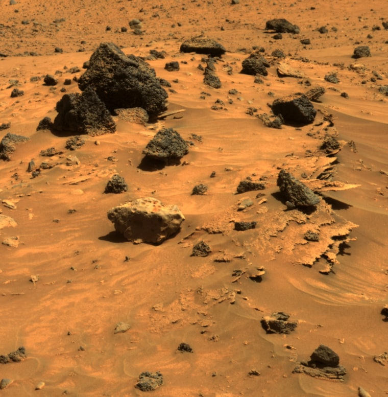 At least three different kinds of rocks await scientific analysis at the place where NASA's Mars Exploration Rover Spirit will likely spend several months of Martian winter. Thin-layered, jagged-edged rocks, rounded gray rocks and lavalike rocks are all visible in this picture, taken April 12.