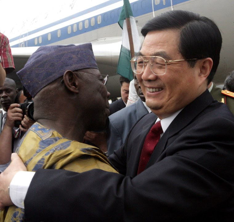 China's President Hu Jintao (R) is welco