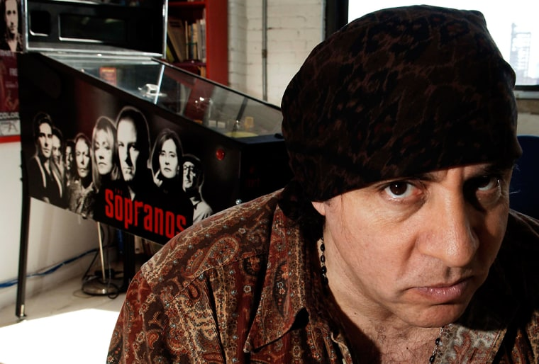 "Musician and actor Steven Van Zandt, who stars as Silvio in HBO's dramatic series ""The Sopranos"" and hosts the weekly syndicated rock and roll radio show ""Little Steven's Underground Garage,"" poses at his radio studio, Monday, March 27, 2006, in New York. (AP Photo/ Louis Lanzano)"