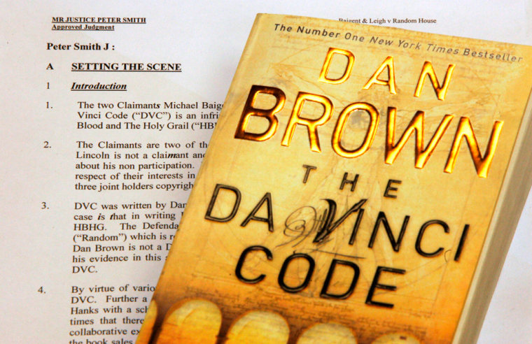 """A copy of the Da Vinci Code novel is set alongside a page from Judge Peter Smith's judgement in the Da Vinci Code trial in London, Thursday April 27, 2006.  The British judge who presided over the Da Vinci Code trial has put a code of his own into his judgment and said he would """"probably"""" confirm it to the person who breaks it.  Italics are placed in strange spots: The first is found in paragraph one of the 360-paragraph long document. The letter S in the word claimants is italicized. In the next graph, claimant is spelled """"claiMant,"""" and so on.  The italicized letters in the first seven paragraphs spell out """"Smithy code,"""" playing on the judge's name.  (AP Photo/Matt Dunham)"""