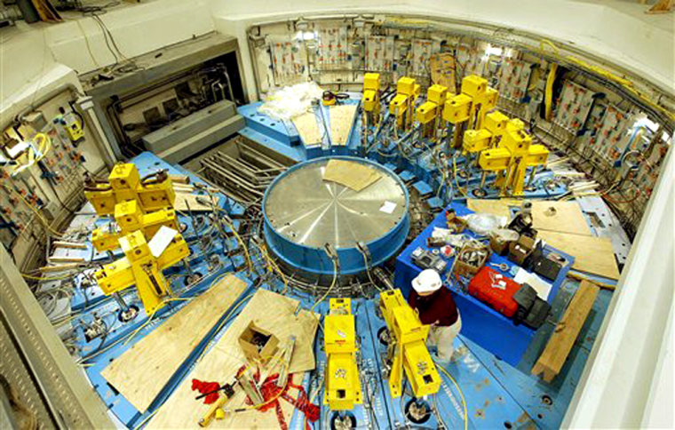 Yellow hydraulic lifts sit on top of the mercury target building at the Oak Ridge National Laboratory's Spallation Neutron Source project in Tennessee earlier this year.