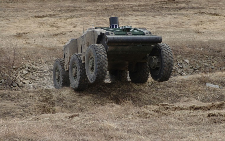 The six-wheeled, 6.5-ton robotic combat vehicle called Crusher can negotiate ditches and 4-foot ledges to get from waypoint to waypoint.