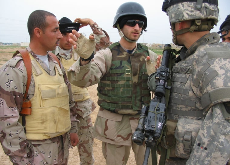 Lt. Aaron Tapalman, 23, argues with some Iraqi soldiers about who will deal with a suspected roadside bomb on a highway near the northern city of Hawijah.