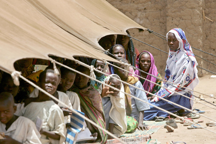 Sudanese refugee children sit in their makeshift classroom April 19 in the refugee camp Kou Kou Angarana in Chad near the Sudan border.