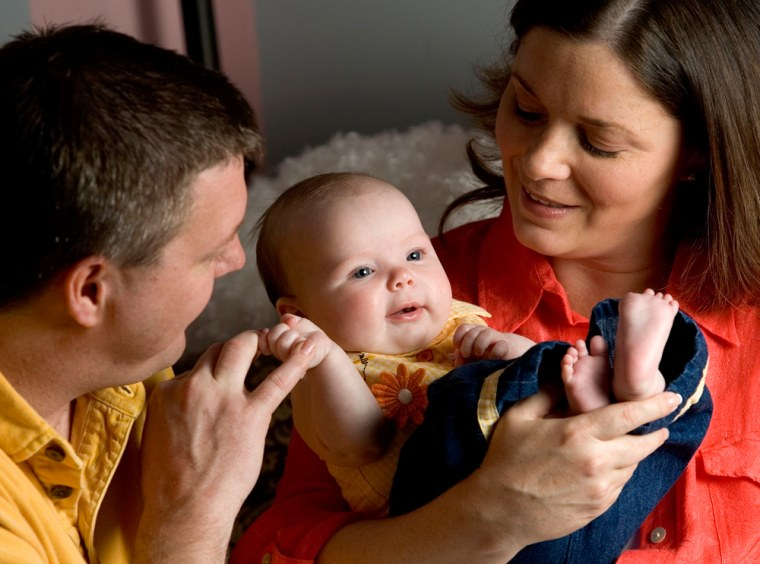Avery Lee, seen withparents, Jared and Wendy Kennedy,is one of the first babies born from a donated frozen egg.