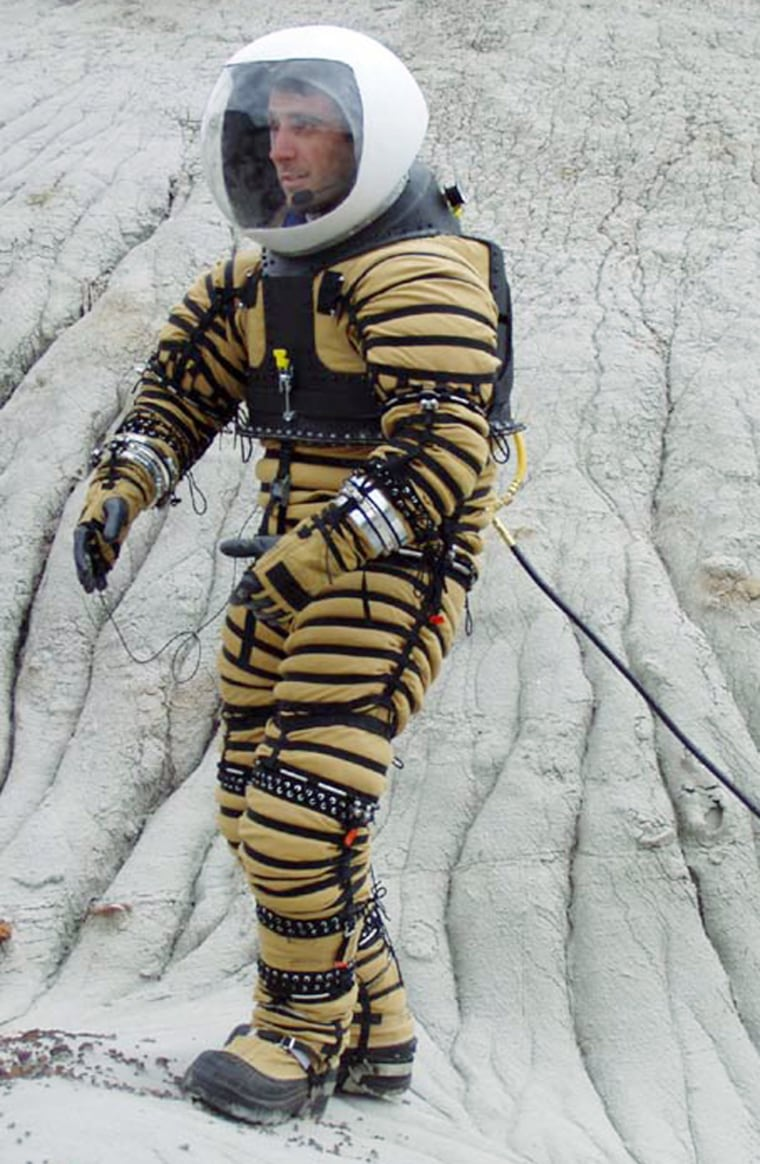 The University of North Dakota's Fabio Sau tries out a prototype Mars spacesuit in the Badlands.