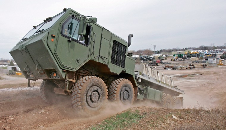Oshkosh Truck, the military's exclusive provider of the Army's heavy cargo-hauling HEMTT vehicles, is finishing up prototypes of its electric hybrid. It not only increases gas mileage by about 20 percent from the standard 3 to 4 miles per gallon, it generates enough electricity to power a city block or hospital.