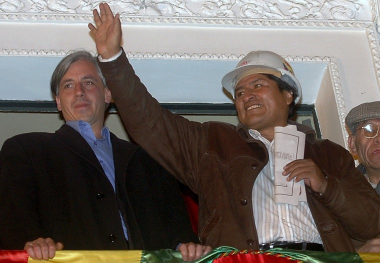 Bolivia's President Evo Morales, right, accompanied by Vice President Alvaro Garcia, wave from the balcony of the presidential palace in La Paz Monday. Morales ordered soldiers to occupy Bolivia's natural gas fields and threatened to evict foreign companies unless they give Bolivia control.
