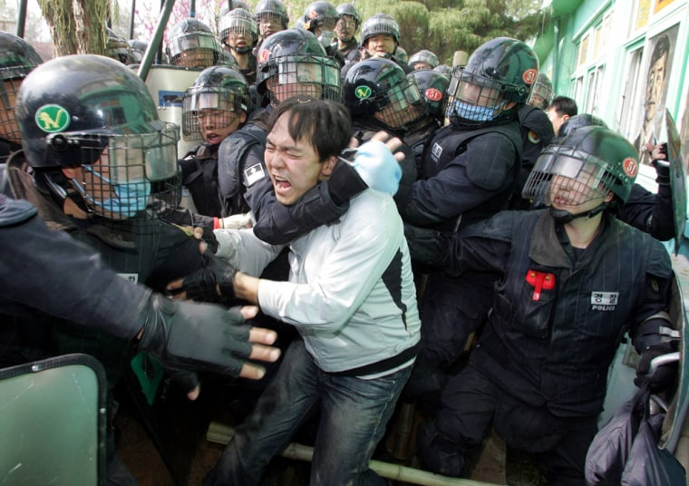 Riot policemen suppress residents and activists at a village near U.S. military bases in Pyongtaek